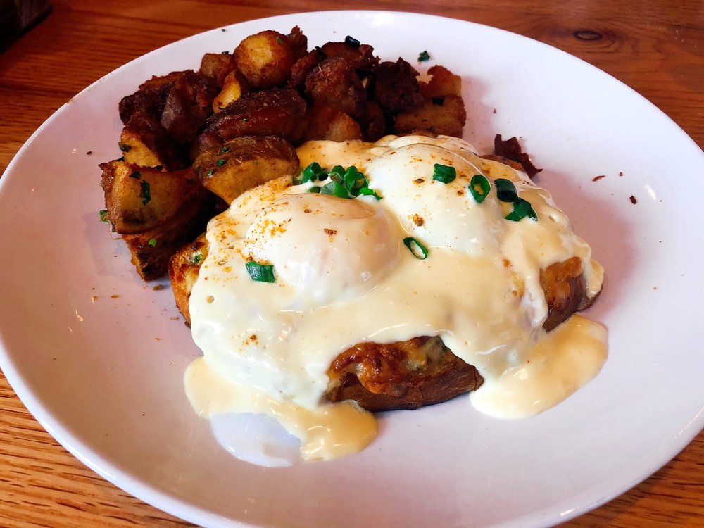 Crab Benedict Served With Jumbo Lump Crab, Roasted Tomato, Fontina, Poached Eggs, Old Bay Hollandaise Served Atop Sourdough Bread And With A Side Of Breakfast Potatoes