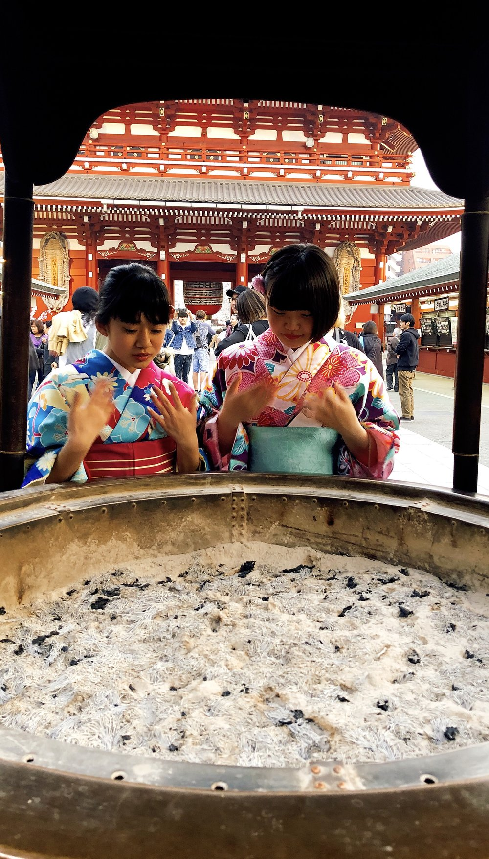 Two School Girls Partaking In Temple Rituals