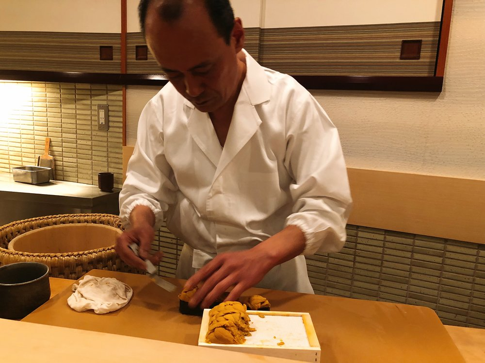 Chef Takashi Ono Preparing The Uni