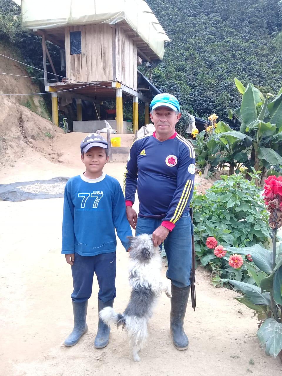 Jose Rincon and his son on their farm