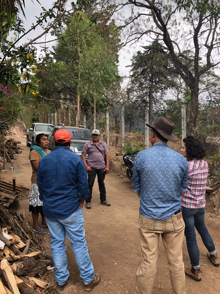 Speaking with local La Cuchilla resident Clara Lopez. She showed us where her son's home used to be, before it collapsed as many in the area have, and pointed out the fence (left) that was built by the mine. This whole side of the road was formerly occupied before the mine arrived.
