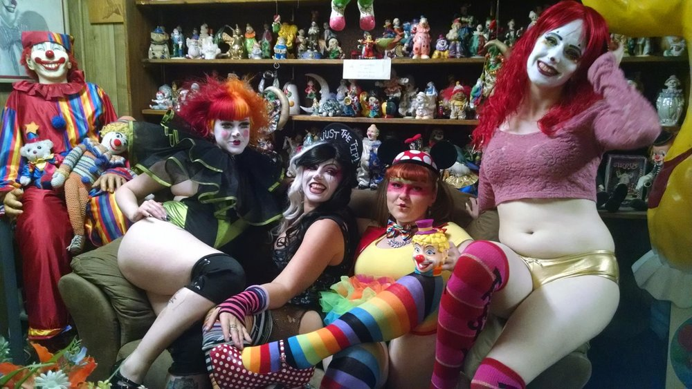 The clown family among their porcelain peers.