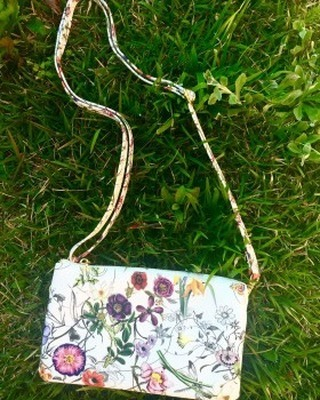 This cross-body bag has us dreaming of spring flowers! http://ow.ly/yCYa30gJJ8H