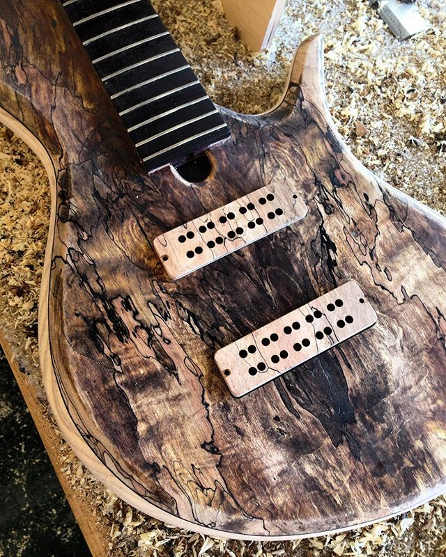 Pickups finally in this beast. I hate cutting in the pickups.  Thanks again @nordstrandpups for the killer wood covers and pickups. • #madebyhandplayedbyhand * #ellabass * * #blackwalnut #bloodwood #maple #wenge #woodworking #luthier #bassguitar #custombass #custombassguitar #notreble #bassforward #bassplayersunited #bassplayermag @bassplayunited @bassplayermag @bass.forward @basstheworld