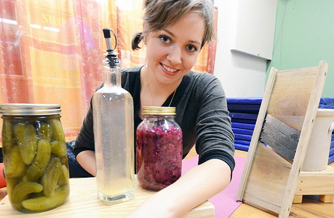 Mark Brett/Western News    Raina Lutz with some of the traditional, healthy foods she brings back into people's homes. Top 40 Under 40- 2014