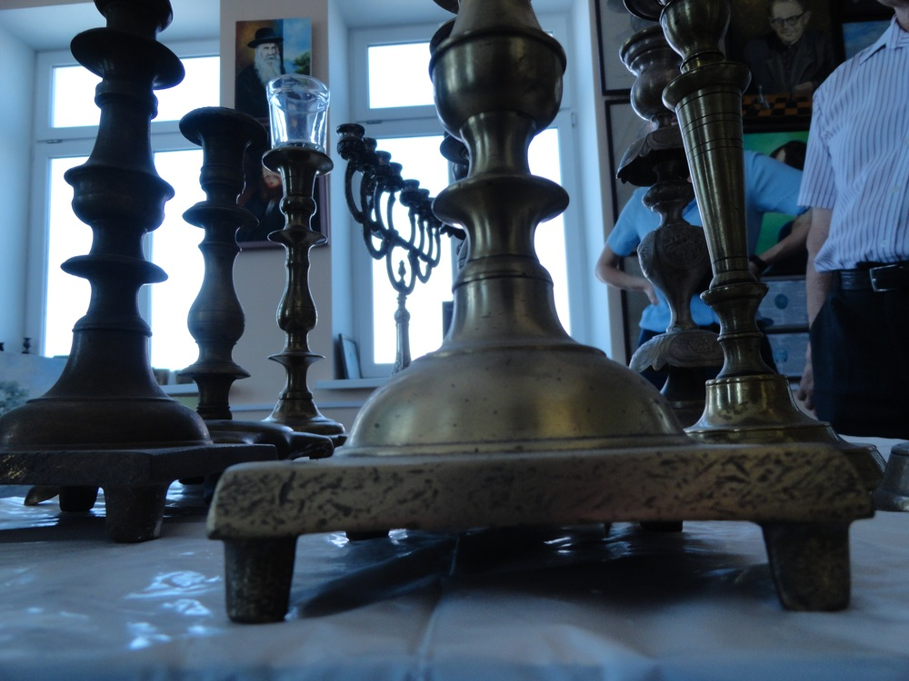 My parents have similar brass candlesticks on a base with feet like these.