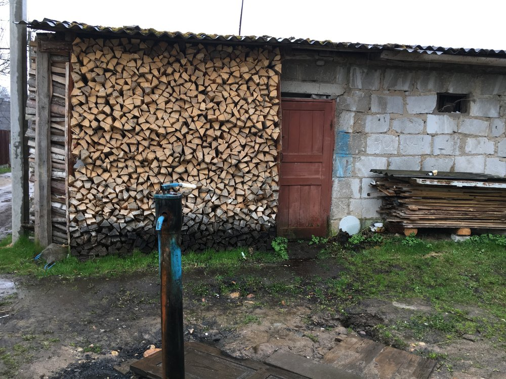Some people use wood burning stoves to heat their houses and have outdoor pumps but all have electricity and indoor plumbing if they want it.