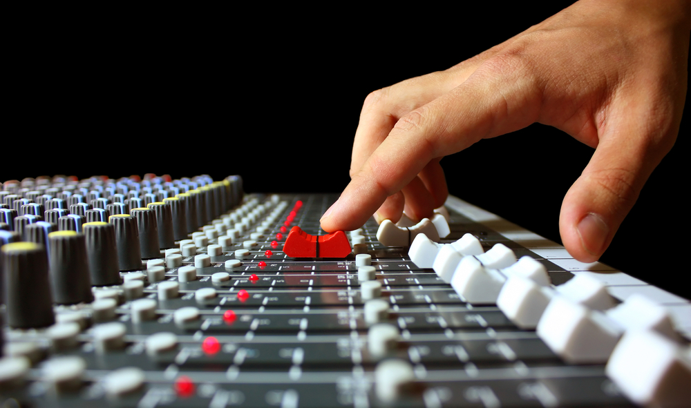 finger-on-mixer-fader.jpg