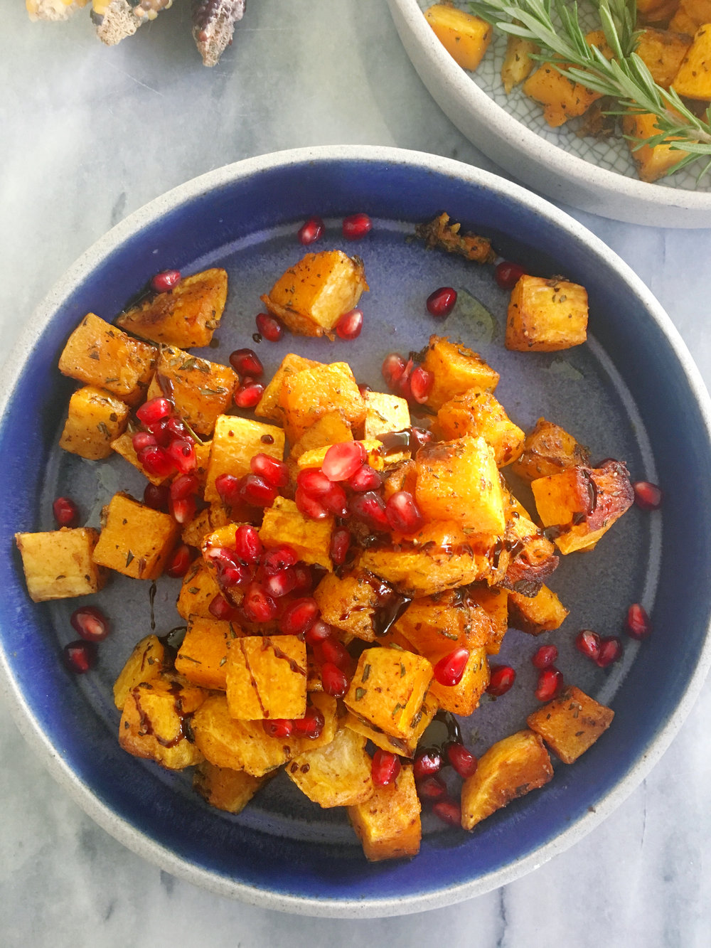 SWEET: Roasted butternut squash baked with fresh rosemary and pumpkin pie spice. Topped with seeded pomegranate and aged balsamic vinegar.