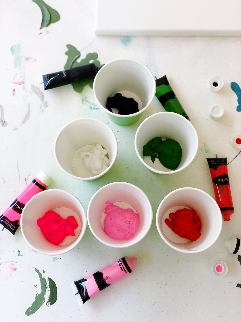 2. Next, place each color of paint into its own separate cup.