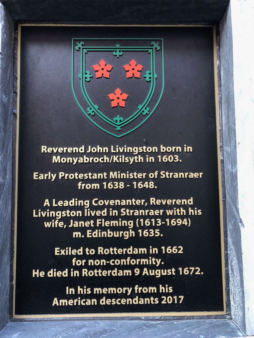 The plaque on the church street wall - an identical plaque is on the gate of the High Kirk