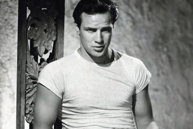 Marlon Brando - It was Marlon Brando who really took the t-shirt from workwear of the military to the mainstream market when he appeared in his white crew neck in A Streetcar Named Desire 1951, prompting t-shirt sales to hit a total of $180 million in the U.S that year. How to wear one like Brando? Make sure your sleeves are slightly too short and your trouser waist is just high enough – cigarettes and six-pack optional.