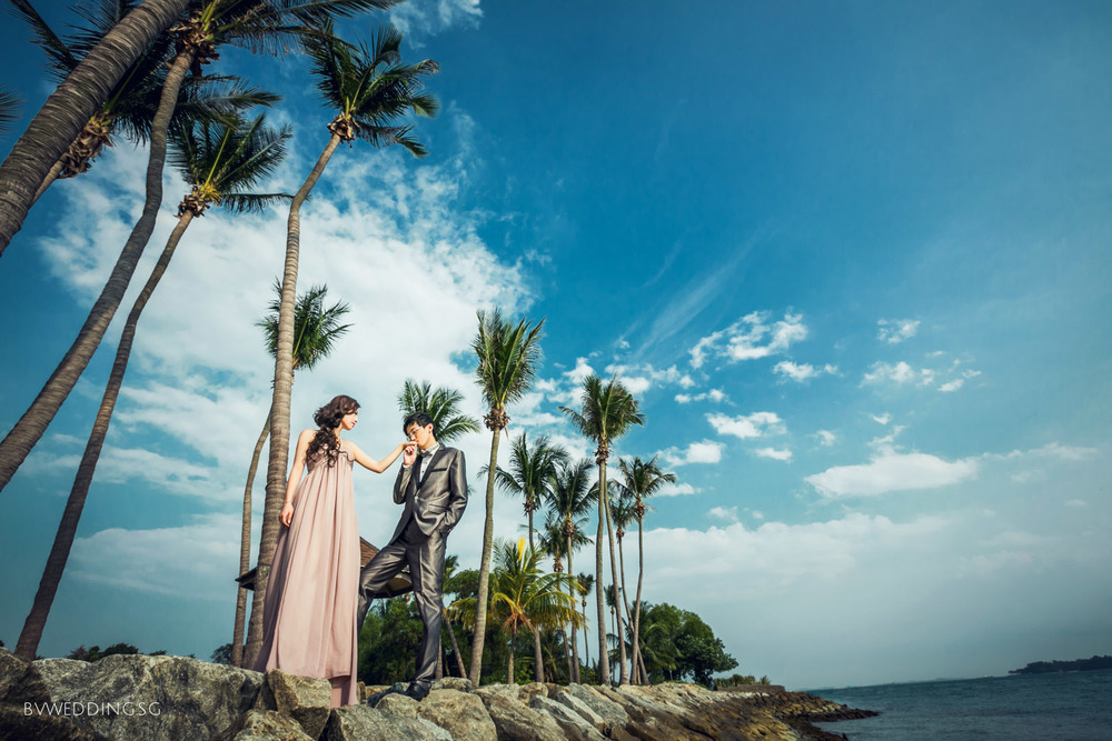 As the yellow yolk of the sun descend down behind the horizon where the sky meets the ocean, the sandy beaches are slowly tinted in amber hue; an amazing place to take romantic pre-wedding photos.