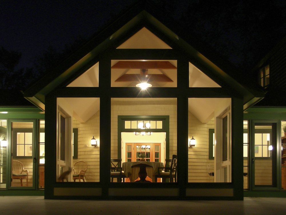 Family Retreat Sun Room at Night by HDS Architecture