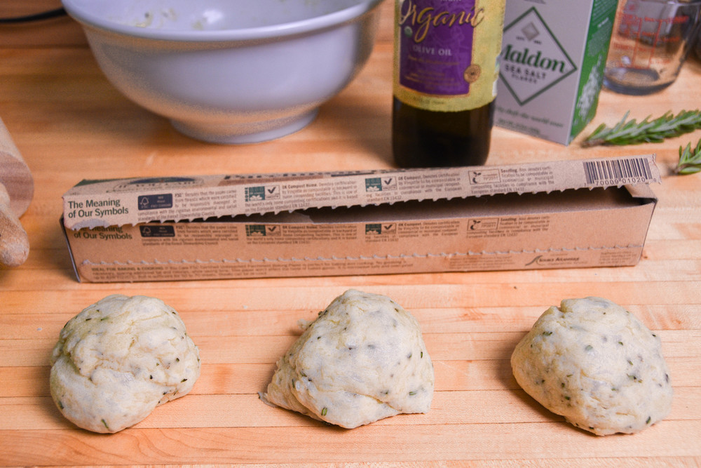 Separate the dough into 3 pieces. Wrap two in plastic and set aside for later. On parchment paper, roll out 1 piece of dough until thin (should be roughly 10 inches).