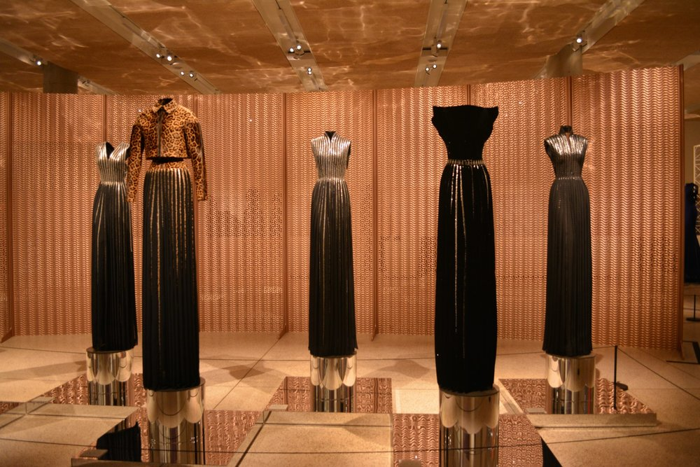 "Decoration and Structure  –  ""Material can trigger a form"".  Instead of adding embellishment onto his pieces to create details, Alaïa instead used the integral fabric of the dress to create interest, for instance, using perforated fabrics, such as broderie anglaise or laser-cut leathers."