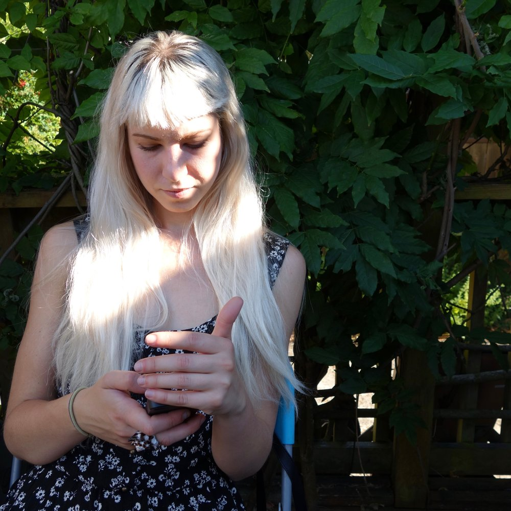 girl with phone.jpg