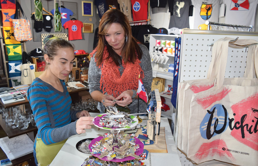 Amy Baptista, left, and Jennifer White browse merchandise at The Workroom. Located in the Douglas Design District, The Workroom is well-known for its Wichita items created by local artists. Photography by Scott Elpers