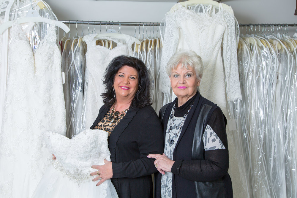Reni Keen, right, has helped brides find the perfect wedding dress for the past 42 years. She  runs the longtime Wichita bridal shop with one of her two daughters, Tonya Keen Lorenz, left. Photo by Whitney Pulen