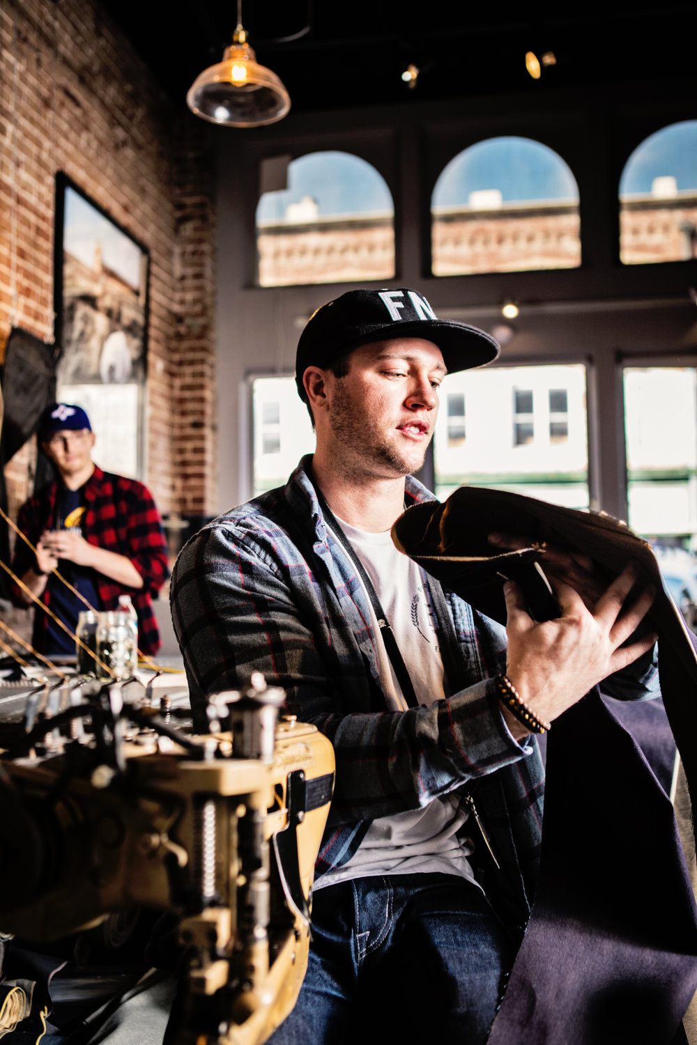 Levi Fitzmier, front, and Frank Hopkins opened a storefront for FNL Denim last August.
