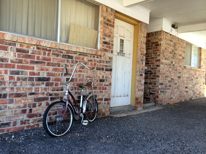 Route 66-Bike leaning on brick wall_adj01-sm.jpg