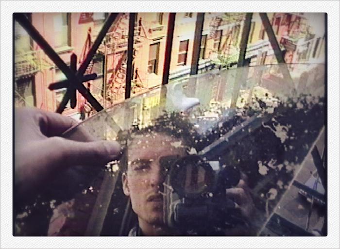 reflection in broken glass, elizabeth street fire escape