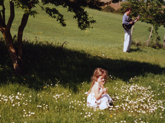 me playing guitar in field with isabelle_adj01-sm.jpg