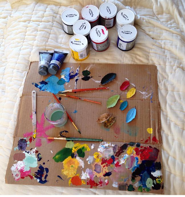 Paints & brushes on cardboard_adj01-sm.jpg