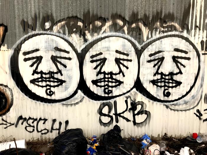 Graffiti-3 faces_adj01-sm.jpg