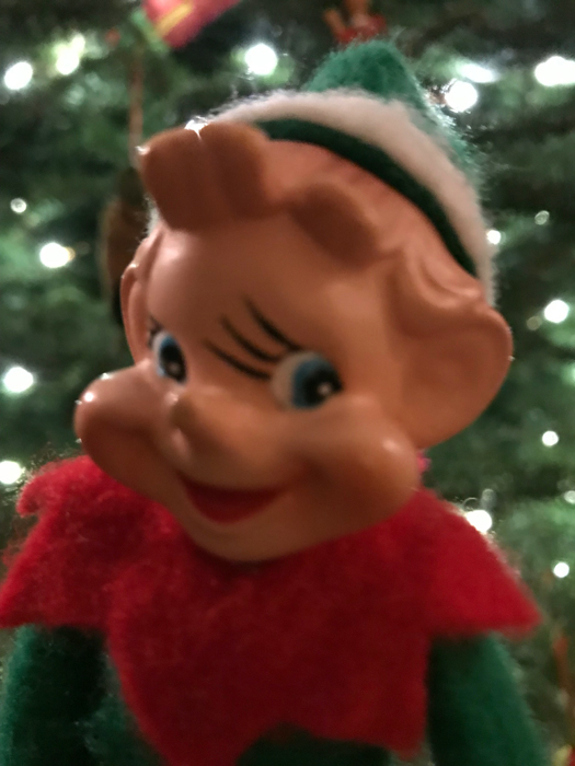 Christmas elf with tree in background_adj01-sm.jpg