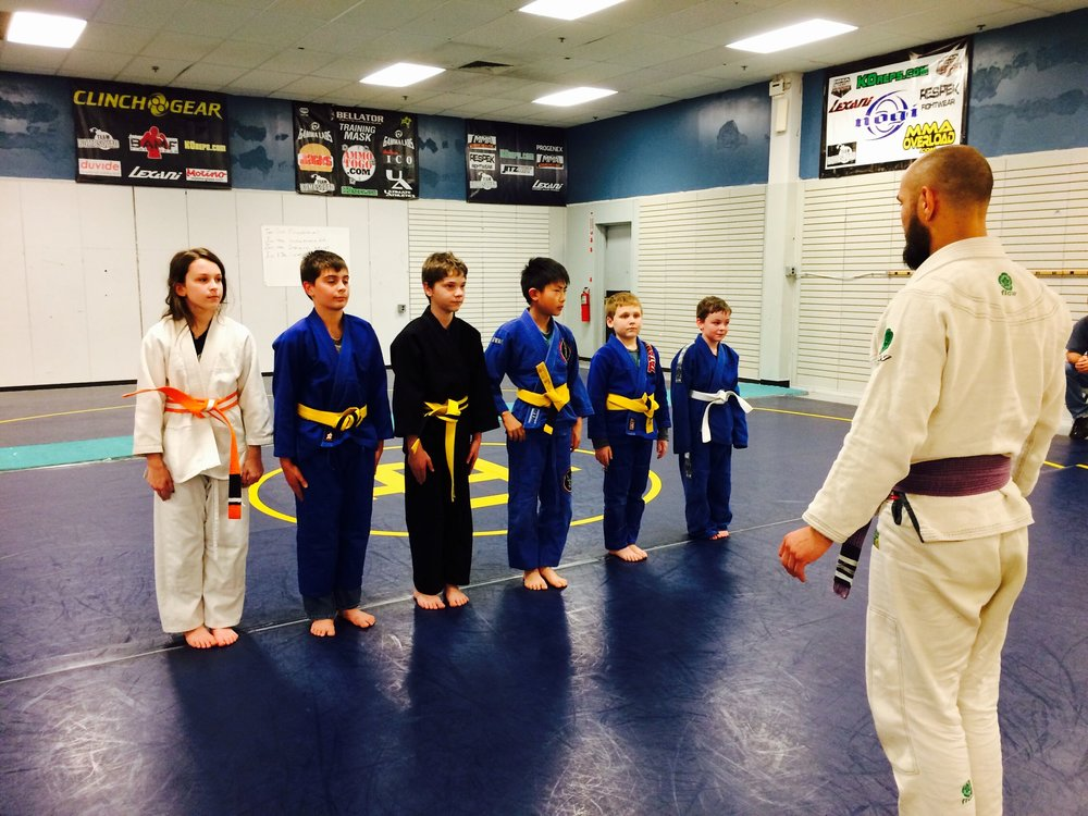 Kids Brazilian Jiu-Jitsu    -    This class emphasizes self discipline and resiliency through grappling as well as basic take downs, take down defense from the standing position and ground submissions. The kids in this class will learn a variety of self defense techniques. All classes are taught in a fun and safe environment.