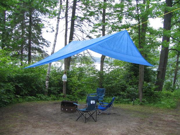 A tarpauline over a ridgeline