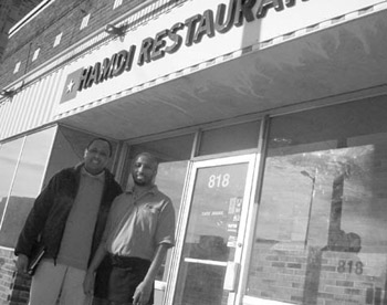 Hussein Samatar (left) with Mustafa Ducoleh of Hamdi Restaurant at Chicago-Lake.