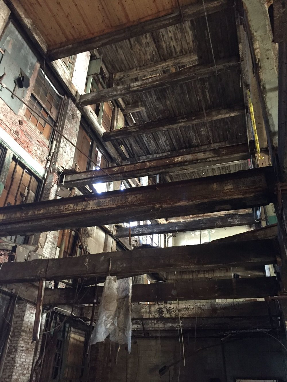 View looking up from the first floor through the five stories of the factory.