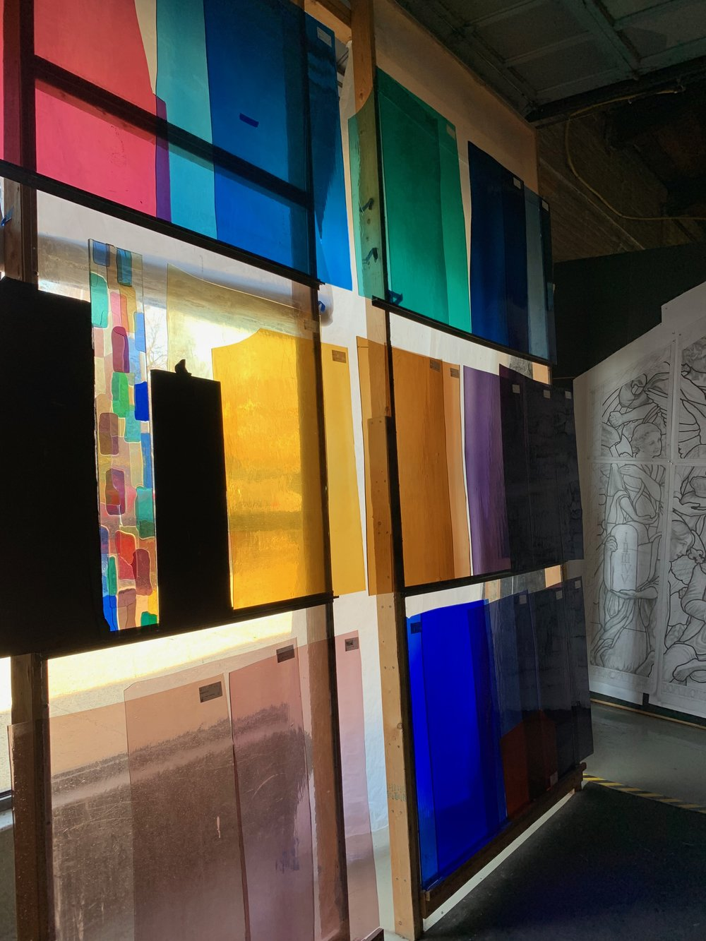 The stained glass windows in progress at Beyer Studio.