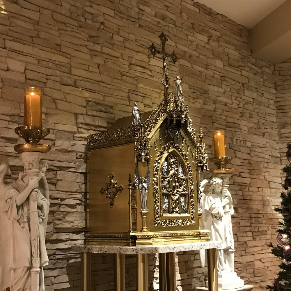 """The Tabernacle Our tabernacle is truly an inspiring Piece of Art, for the glory of God. Art has two purposes, we are told: 1. to edify, 2. to teach. Certainly this Tabernacle is edifying in its beauty and grandeur, but it teaches us too, what is most important to us, and that is the Eucharist, the most Precious Gift Christ left his Church. St. Maximilian Kolbe said: """"if angels could be jealous of men, that would be so only for one reason, the Eucharist (since angels do not have bodies, they cannot eat the very substance of Christ: Body, Blood, Soul and Divinity."""