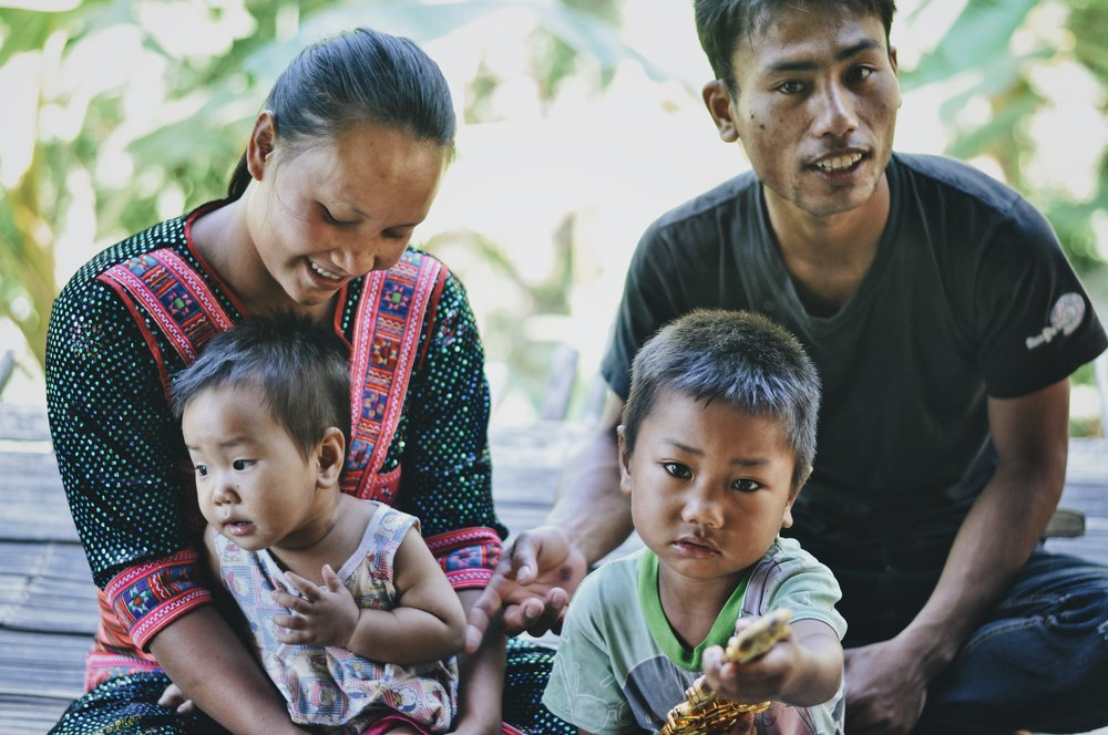 """Hi I am Ah Boh, my wife is Nah Lo Kah. We have lived in this village for about three years. I used to live here when I was young. I left for school in another village. I got engaged, then married, and I moved back and have been in this village for three years.  They grow rice and corn in this village.  Farming is hard work. It's hard growing rice and corn. For corn, we sometimes have to use herbicides when it gets too hard. The forest is important because having a forest means you have a good environment, you have a cool weather.  Families here do not have their own land or knowledge for farm management. In this village, land management is different because it belongs to the village chief. They can use the land but cannot own it because it belongs to the chief. They want to have their own land, they want to have their own trees. They don't know how to do this yet, while the land belongs to the chief."""