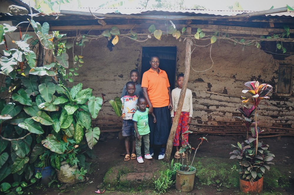 Ellie showed us where she used to live- a mud-and-clay structure, small in space. This was her whole house when she joined Plant With Purpose's program.  Some relatives were ill, and she had signed up to take care of their children. Before she had much to give, she already had a very generous spirit.  It's great when generous people succeed. Through hard work and the help of Plant With Purpose's program, she was able to make upgrades to the home, eventually making a much nicer and more spacious home, right on the same plot as her old abode. She now uses it as her laundry room.