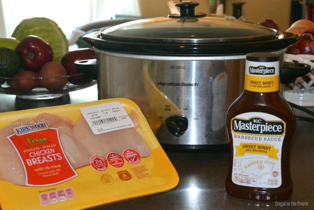 This is the easiest 2 ingredient slow cooker BBQ chicken recipe! #KCMasterpiece helps me keep things delicious with Sweet Honey and Molasses Barbecue Sauce.