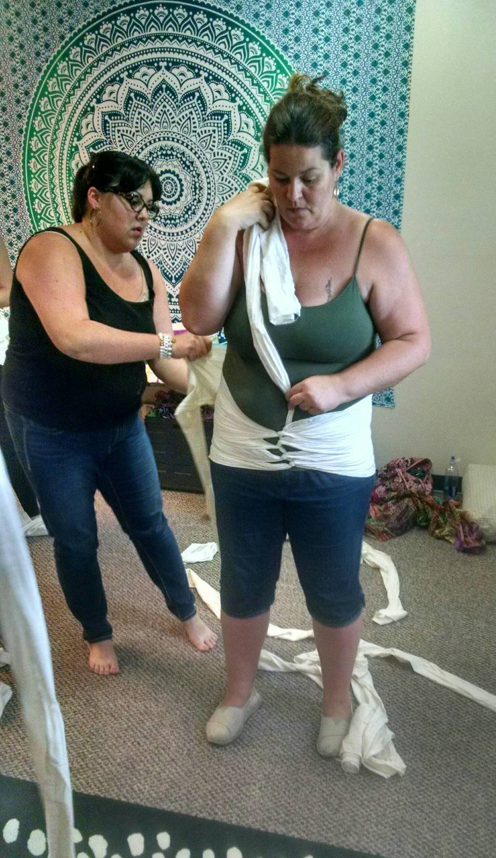 Trainer Devon Mullins demonstrates Bengkung Belly Binding