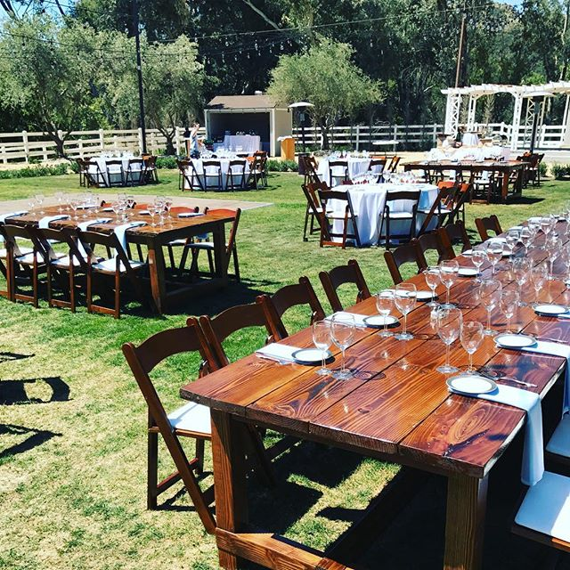❤️ the hand crafted wood tables & folding rounds! #wehaveitall #eclectic #HisandHersRentals #farmtable #friends #family#fridaynight #glasses #linens #chairs #wedding #event #americana #vintageseating #wedding2017 #la #malibuwedding #loveseat #caterer #food #reception #ceremony #builtnotbought #rustic #rusticdecor #benches#plates#forks#knives #rentals