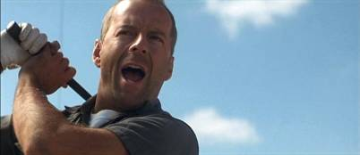 Here's Bruce Willis (aka Michael Bay) hitting golf balls at liberals