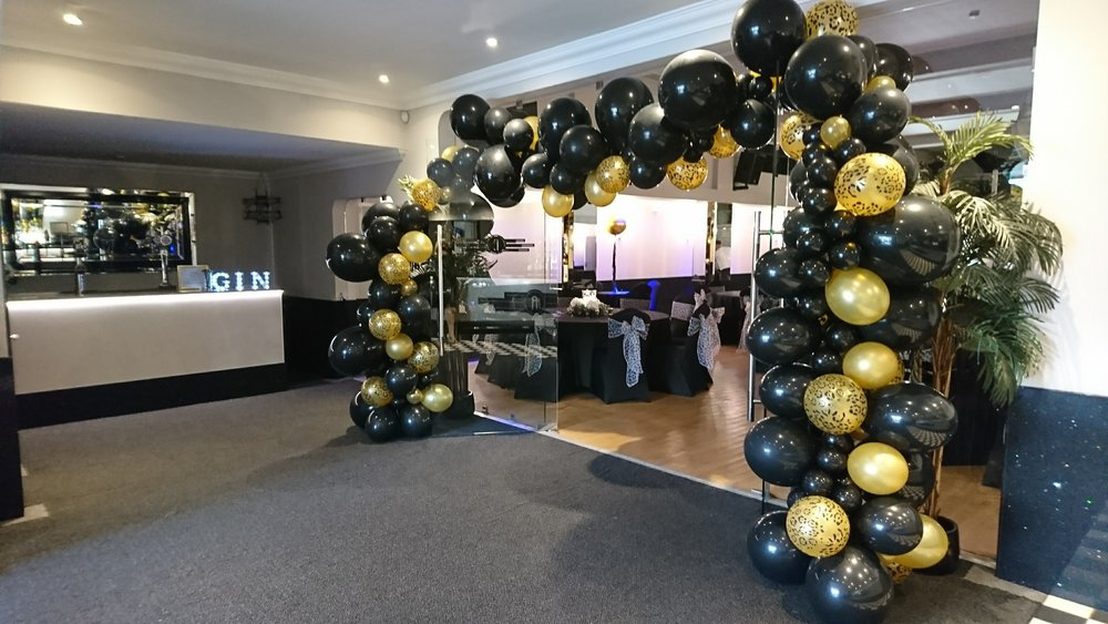 black and gold balloon arch for party at The Arlington Ballroom Southendjpg