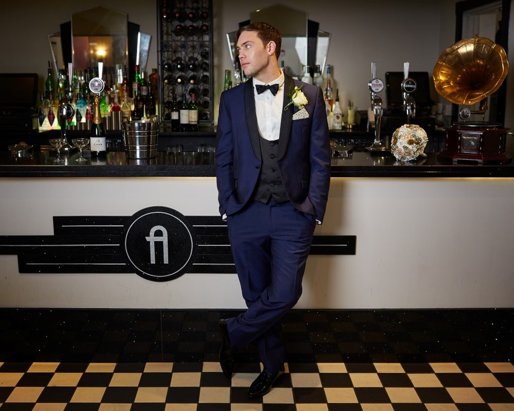 Groom at bar The Arlington Ballroom Essex Art Deco shoot