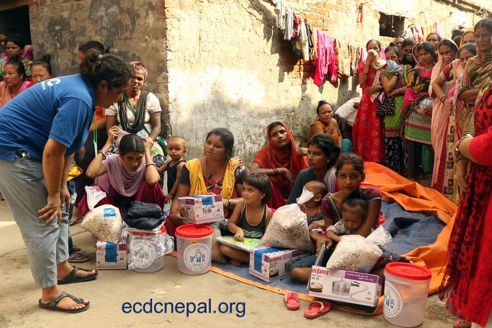 Pushpa Basnet (Left) leading the distribution and briefing as part of the nutrition program