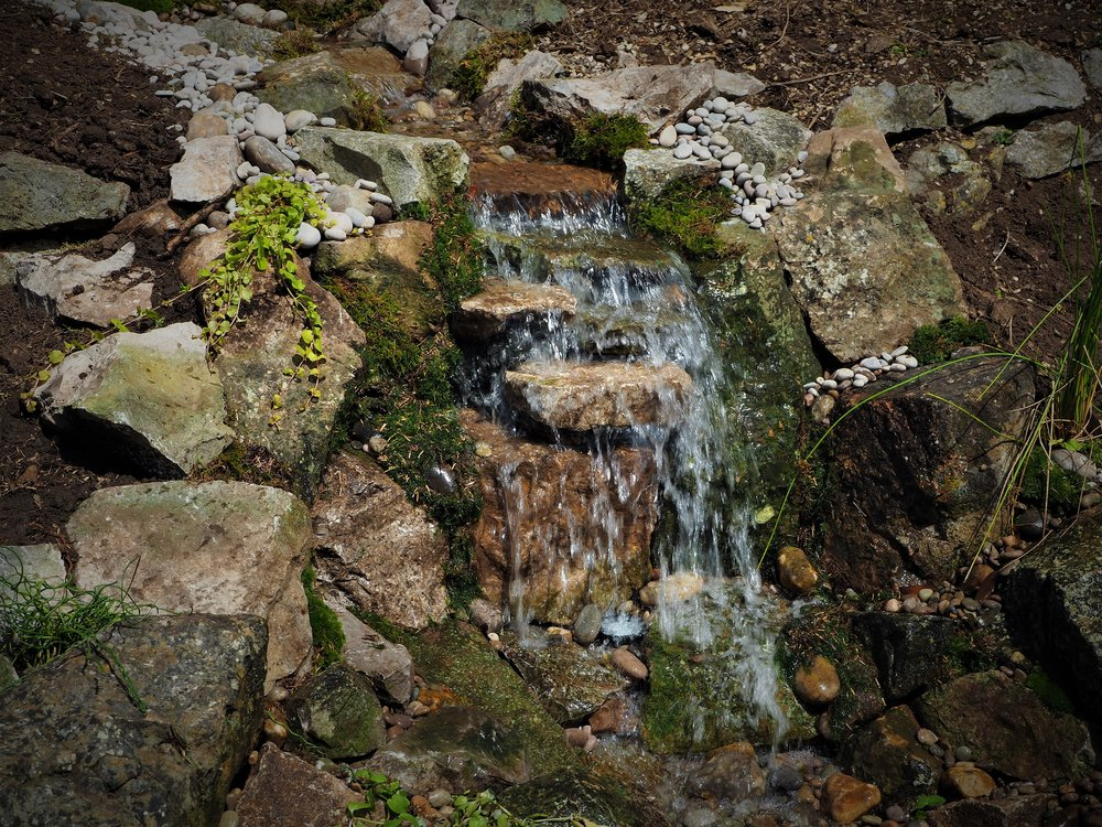 This water fall could be loosing water through excess splashing