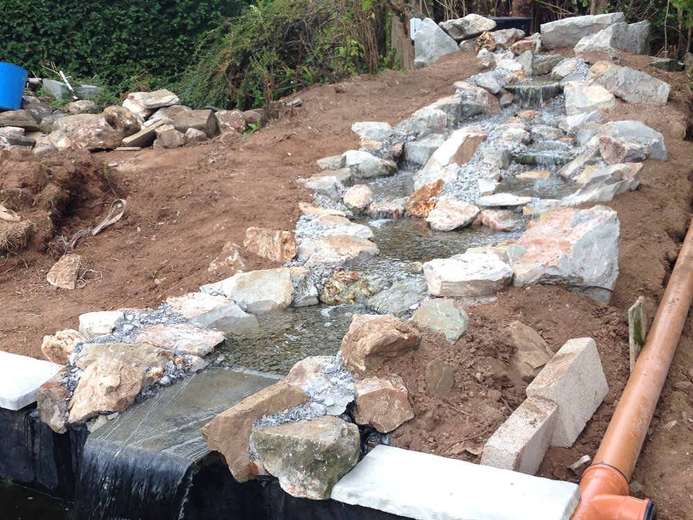 After… - Large naturalistic water feature