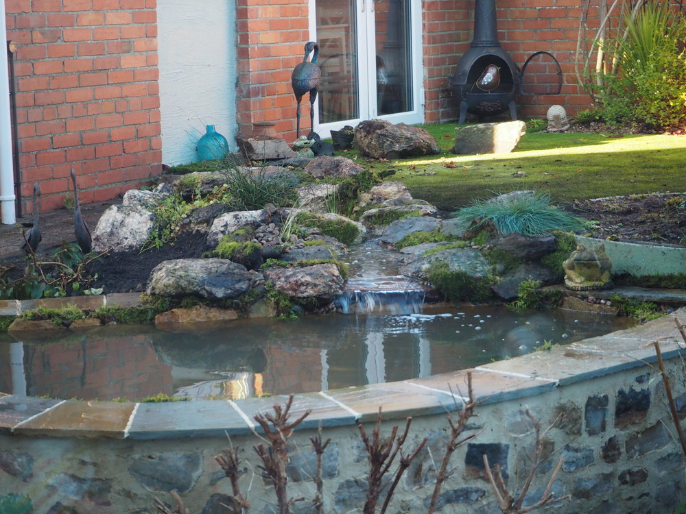 After… - New brook babbling its way to the formal pond