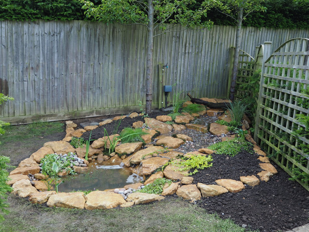 After… - A stream and micro pond, a perfect addition to this corner space