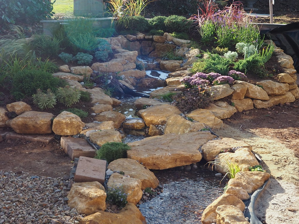 After… - One-of-a-kind disappearing water feature with bridge stone